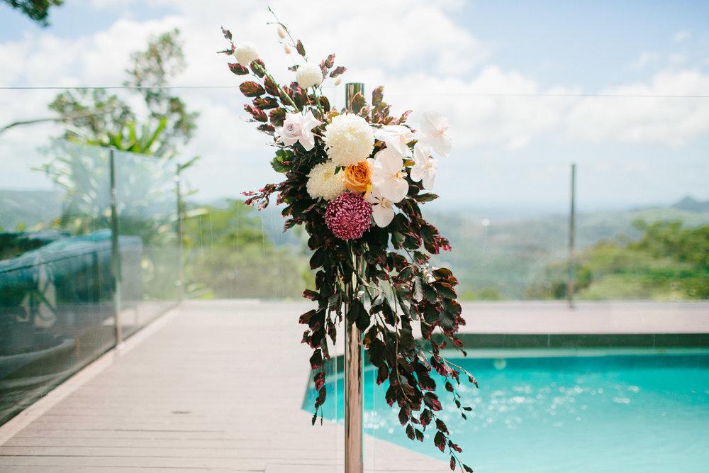 Bloodwood Botanica   Floral fence wedding flowers byron bay