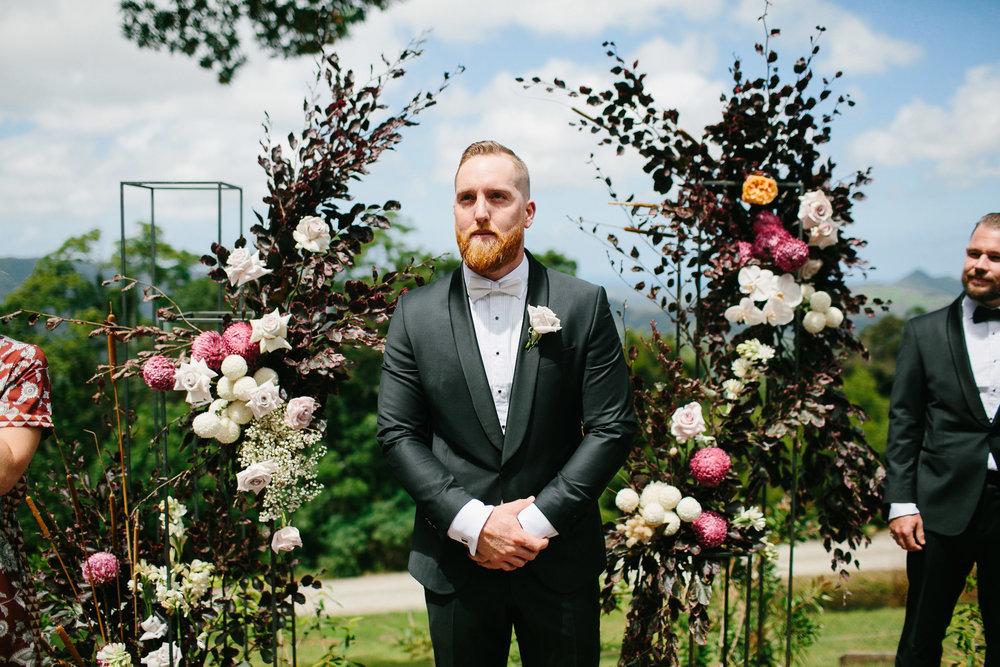 Bloodwood Botanica   dapper groom wedding flowers byron bay