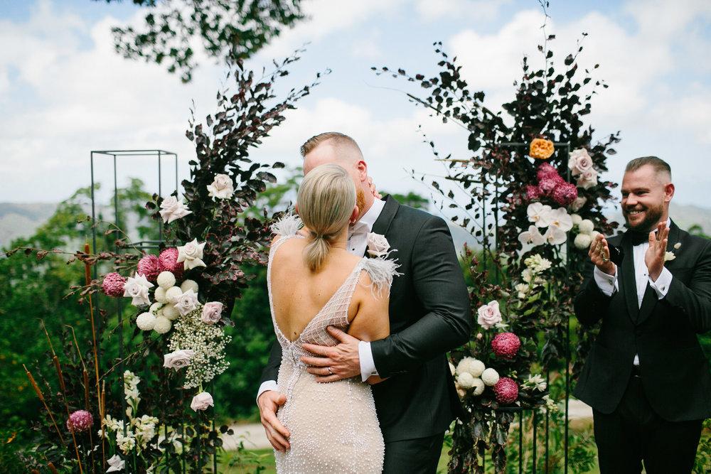 SB_w-384.jpgBloodwood Botanica   First kiss Happy couple byron bay wedding flowers