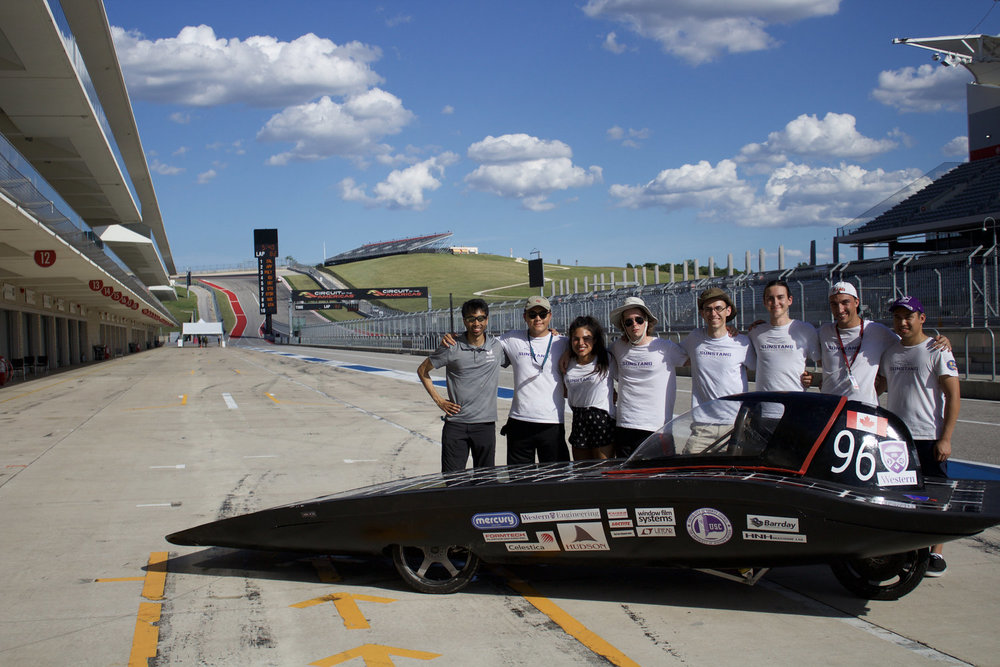The team poses with the car at the end of the event. A week of hard work pays off as SunStang reached the track on two of the three race days.