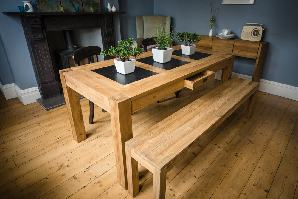 Our one-of-a-kind LAVA dining tables have plates of smooth volcanic lava inlaid in their tops. Glossy black lava provides a heatproof, durable surface as well as a striking colour contrast against our honey coloured reclaimed teak.