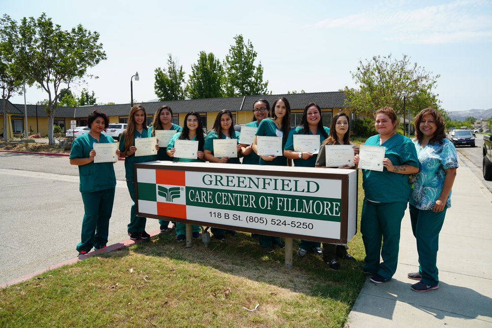 Greenfield Care Center in Fillmore has graduated their first 2017 CNA class.  The next class will start on the second week of August.  To register for the class please go to Greenfield Care Center  at 118 B St in Fillmore to complete an application. The instructor Beatrice Colin/LVN will then schedule an interview with them.   Graduates from left to right are: Itzel Lopez, Shovita Herrera, Denise Martinez, Destiny Orozco, Janet Espinoza, Marcela Hernandez, Silvia Garcia, Adriana Mercado, Jessica Acevedo, Blanca Reynoso and Instructor: LVN Beatrice Colin