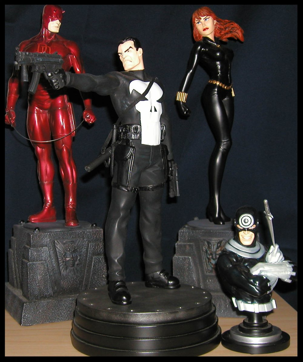 Bowen Statues featuring (L-R) Daredevil, Punisher, Black Widow, and Bullseye.  Yes, this is some of the stuff I collected.