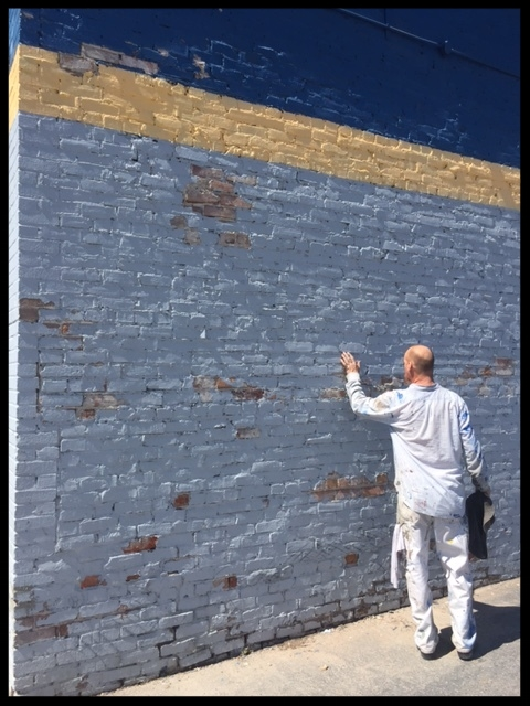 Our painter prepping a building we purchased.
