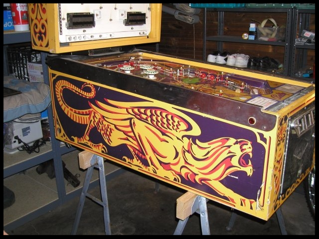 I preferred to work on pinball machines while on sawhorses.  It put them up a bit higher for easier repairs.