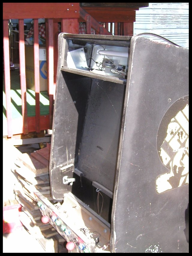 A poor, poor Stargate machine.  Steve ended up parting out the boards and control panel for eBay sales.  The rest of the machine went to video game hell (again, the dump).