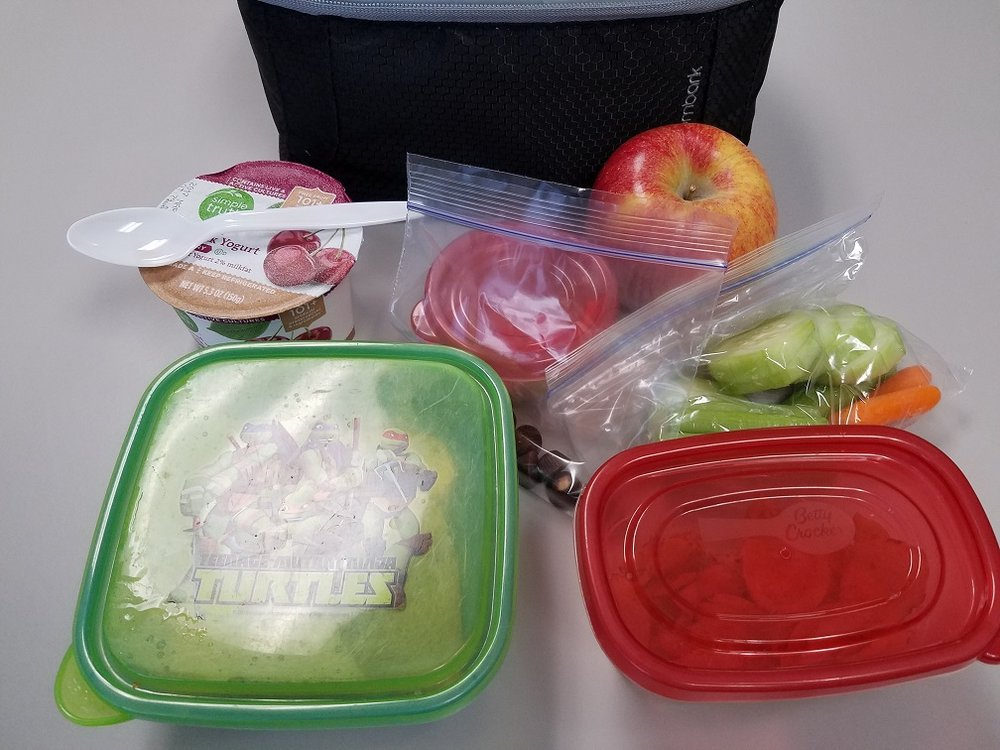 The contents of my lunchbox one day this past week - (PB&J sandwich, chips, veggies with hummus, yogurt, apple and a few mini peanut butter cups).   This post may contain affiliate links.  Learn more by reading my  disclosure .