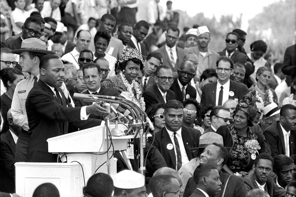 "PAGE 73: DR. MARTIN LUTHER KING, JR. BECAME AN INTERNATIONAL LEADER FOR SOCIAL, POLITICAL, AND ECONOMIC EQUALITY AS HE DELIVERED HIS FAMOUS ""I HAVE A DREAM,"" SPEECH BEFORE A QUARTER OF  A MILLION  ATTENDEES DURING THE MARCH ON WASHINGTON FOR JOBS AND FREEDOM ON AUGUST 28, 1963 (PERMISSION OF THE LIBRARY OF CONGRESS, PRINTS AND PHOTOGRAPHS DIVISION)."