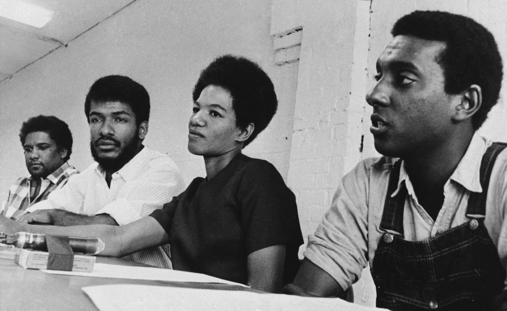 PAGE 60: THE PHILOSOPHY AND DIRECTION OF SNCC SHIFTED DRAMATICALLY IN 1966 WHEN STOCKELY CARMICHAEL (FAR RIGHT) SUCCEEDED JOHN LEWIS AS CHAIRMAN. RUBY DORIS SMITH ROBINSON REPLACED JAMES FORMAN AS EXECUTIVE SECRETARY, AND CLEVELAND SELLERS WAS ELECTED AS PROGRAM DIRECTOR (PERMISSION OF THE ASSOCIATED PRESS).