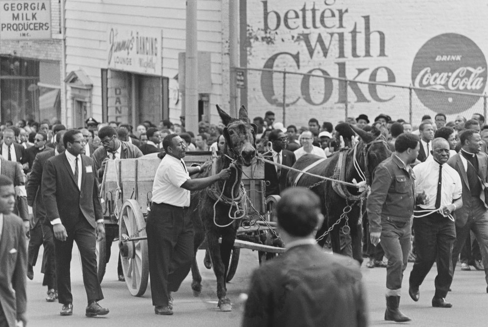 PAGE 118: AN ESTIMATED 200,000 PEOPLE LINED THE STREETS OF ATLANTA TO VEIW OR TO WALK BEHIND THE MULE-DRAWN WAGON CARRYING THE BODY OF DR, KING.                  THE MOVING SCENE WAS VIEWED BY MORE THAN 120 MILLION VIEWERS ON LIVE TELEVISION.