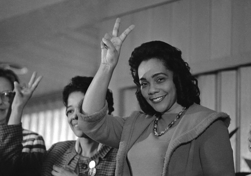 PAGE 126: A FEW MONTHS AFTER HER HUSBAND'S DEATH, CORETTA SCOTT KING ANNOUNCED HER PLANS TO ESTABLISH THE MARTIN LUTHER KING JR. CENTER FOR NONVIOLENT SOCIAL CHANGE IN ATLANTA. IN 1983. THE FEDERAL HOLIDAY HONORING DR. KING WAS SIGNED INTO LAW BY PRESIDENT RONALD REGAN (PERMISSION OF THE ASSOCIATED PRESS).