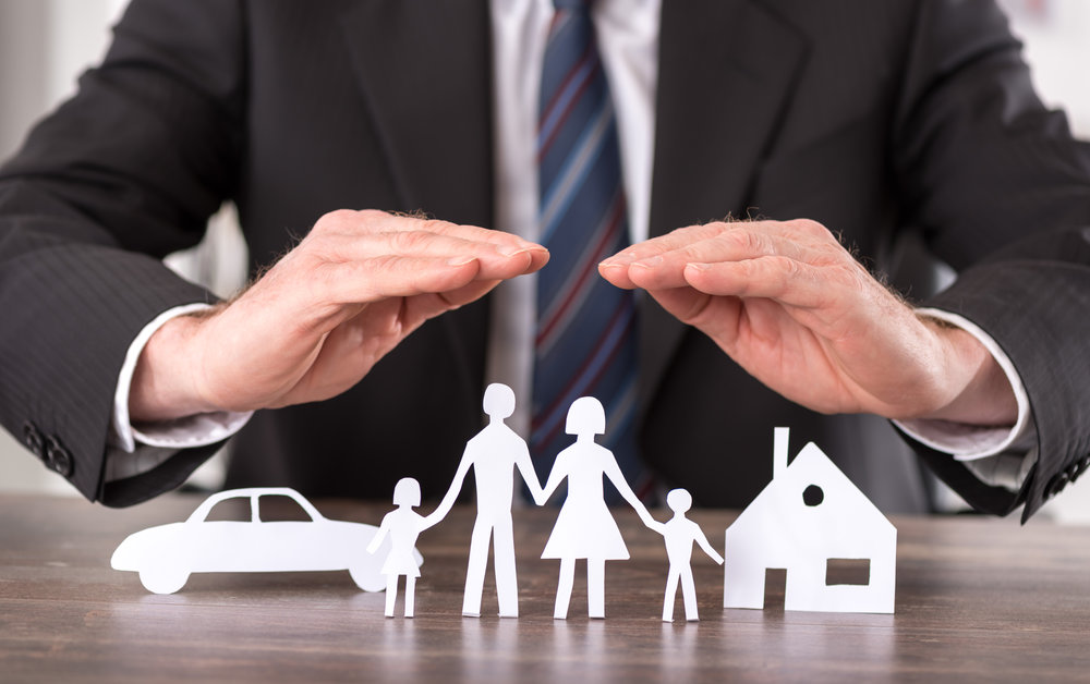 stock-photo-concept-of-insurance-with-hands-over-a-house-a-car-and-a-family-371999371.jpg