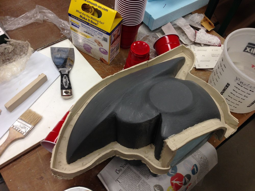 3) Coated form with plastic primer for final finish then created dam walls for two-part silicone mold