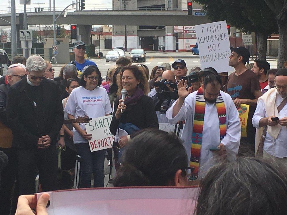 Rev. Alexia Salvatierra leading group prayer