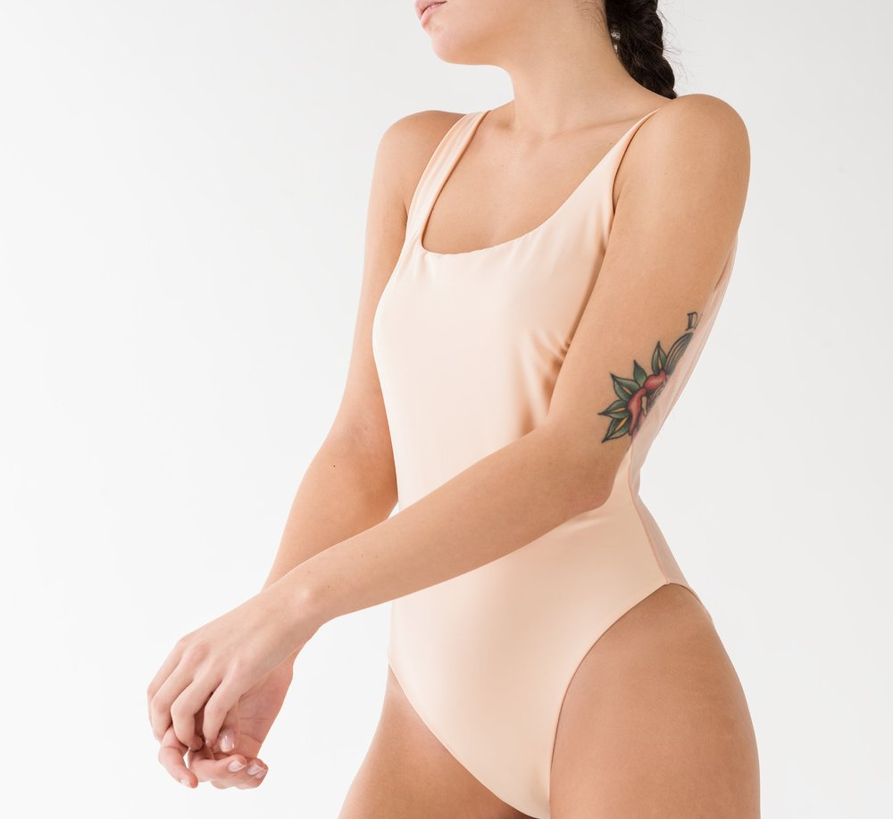 Four one-piece models, all reversible and lined with the same soft tulle of their see-through inserts. -