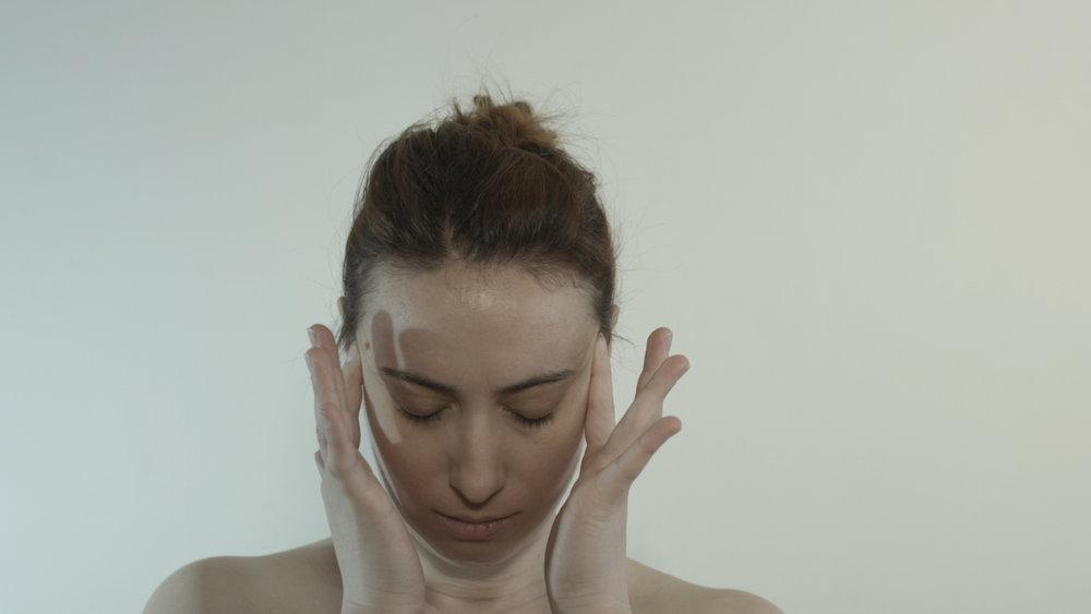 Elena Face Hands.jpg