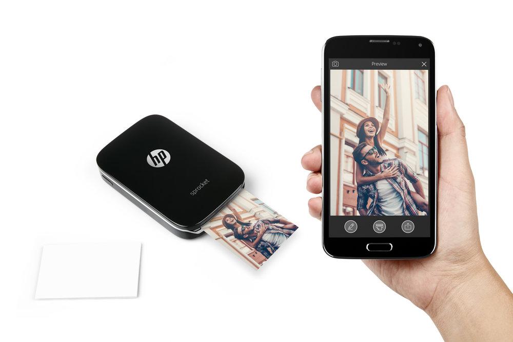 Black Sprocket with phone in hand, printing.jpg