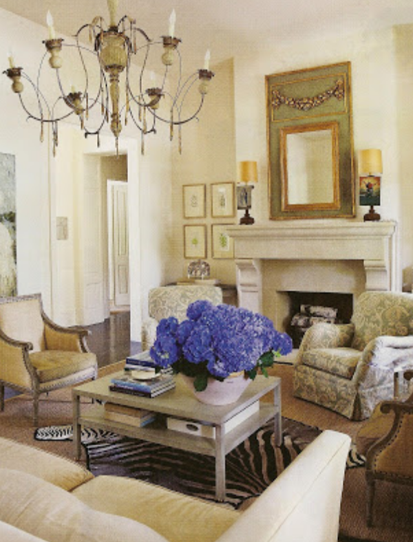 A mass of blue hydrangea brings color to this peaceful  neutral room  of creams and ivories.