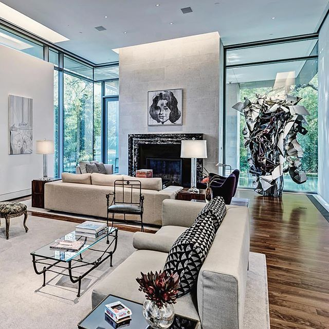 The living room in the modernist mansion of collectors Gayle and Paul Stoffel. Luc Tuymans' 'Egypt'(2003), Andy Warhol's 'Campbell Tomato Juice Box (1964) and 'Silver Liz' (1963) and John Chamberlain's sculpture 'Crawling Cross' (1988). Bronze 'Berceau' table and a 'Tete de Lioness' chair by Diego Giacometti. Photography by James F. Wilson.  #interiordesign #interiors #design #diegogiacometti #giacometti #andywarhol #art #artist #architecture #painting #chair #livingroomdecor #decor #homedecor #contemporaryart #midcenturymodern designcrush #interiur #decoracion #modernart #livingroomdecor #luxury #luxurylifestyle #johnchamberlain #custominterior #bespokedesign #karlspringer #karlspringerltd