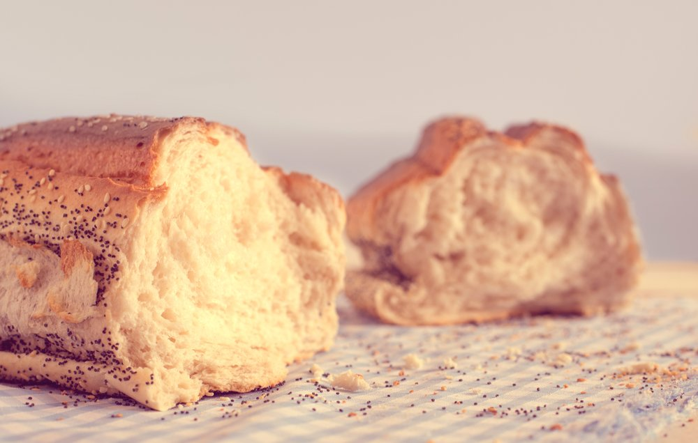 A photograph of a broken loaf of white bread