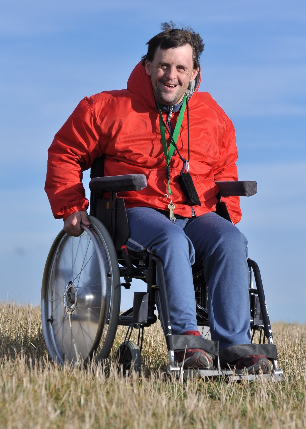 happy man wheelchair disability.jpg