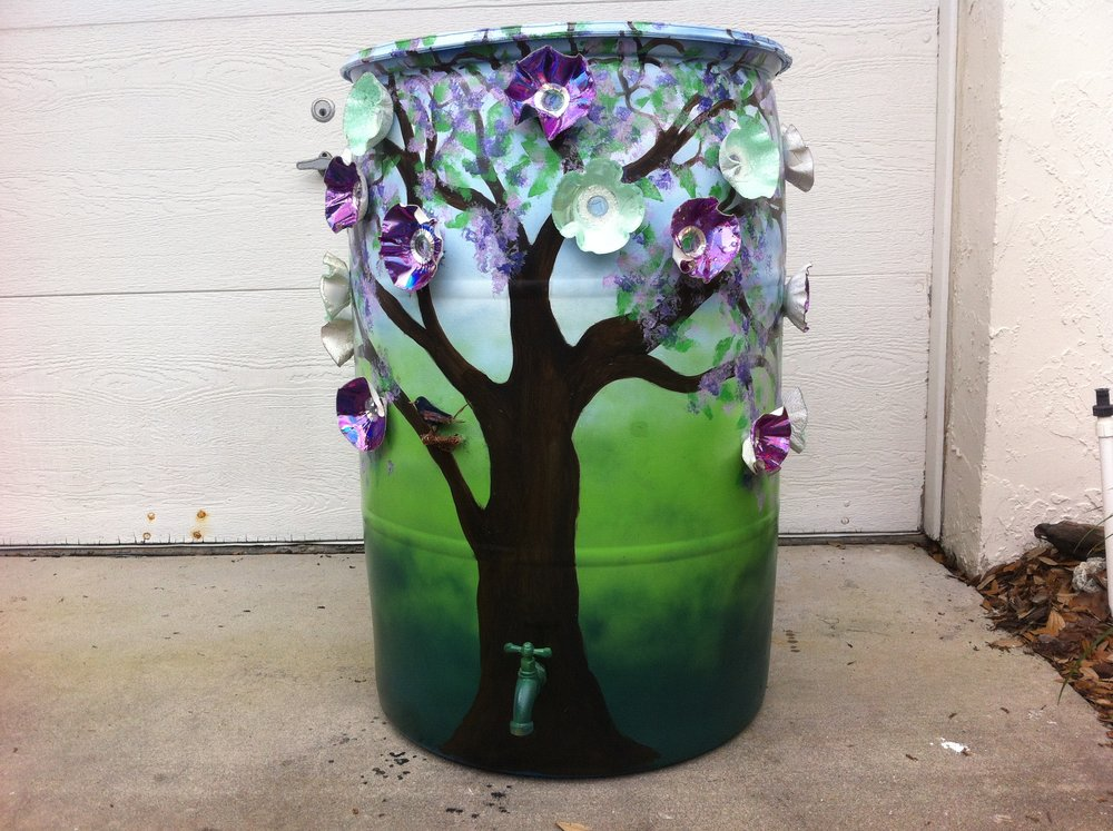 A rain Barrell decorated with Flowers made of CD's