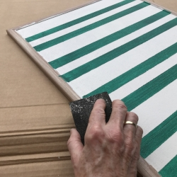roughen the frame with sandpaper