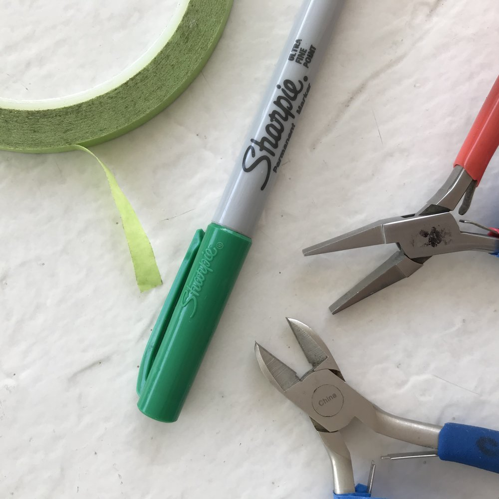 Tools - The tools and wire wrapping supplies you need are: flat nose pliers, and wire cutters. You also need narrow tape and an extra fine point permanent (Sharpie) marker. Pliers should have smooth flat blades that won't mar the wire.