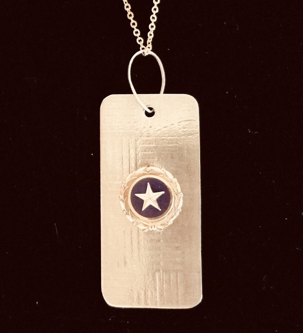 The Gold Star Pin can be worn as a pendant or pin.