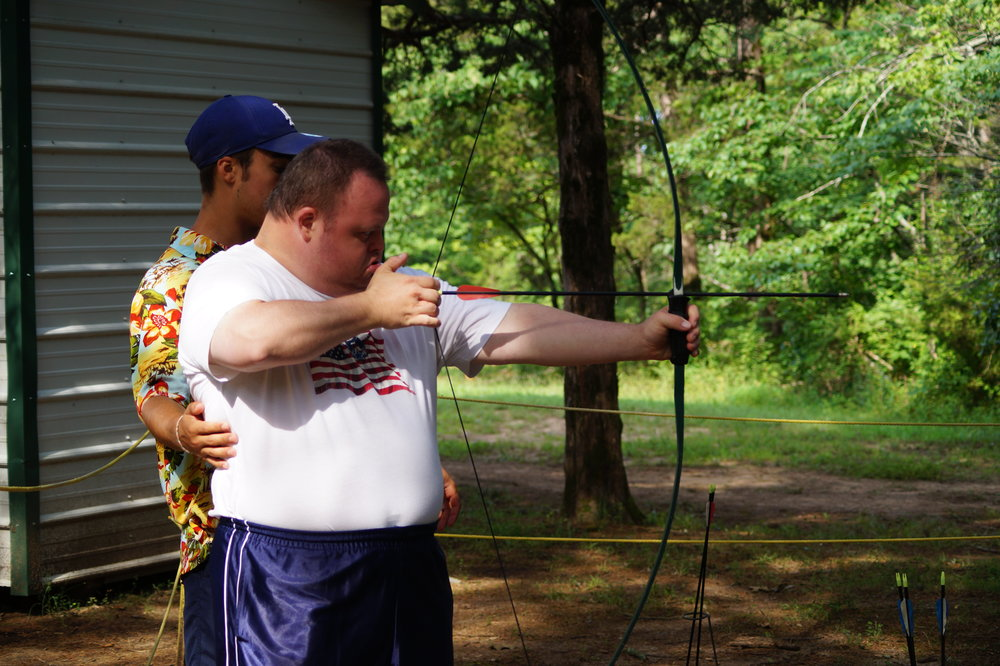 Tim practicing his archery