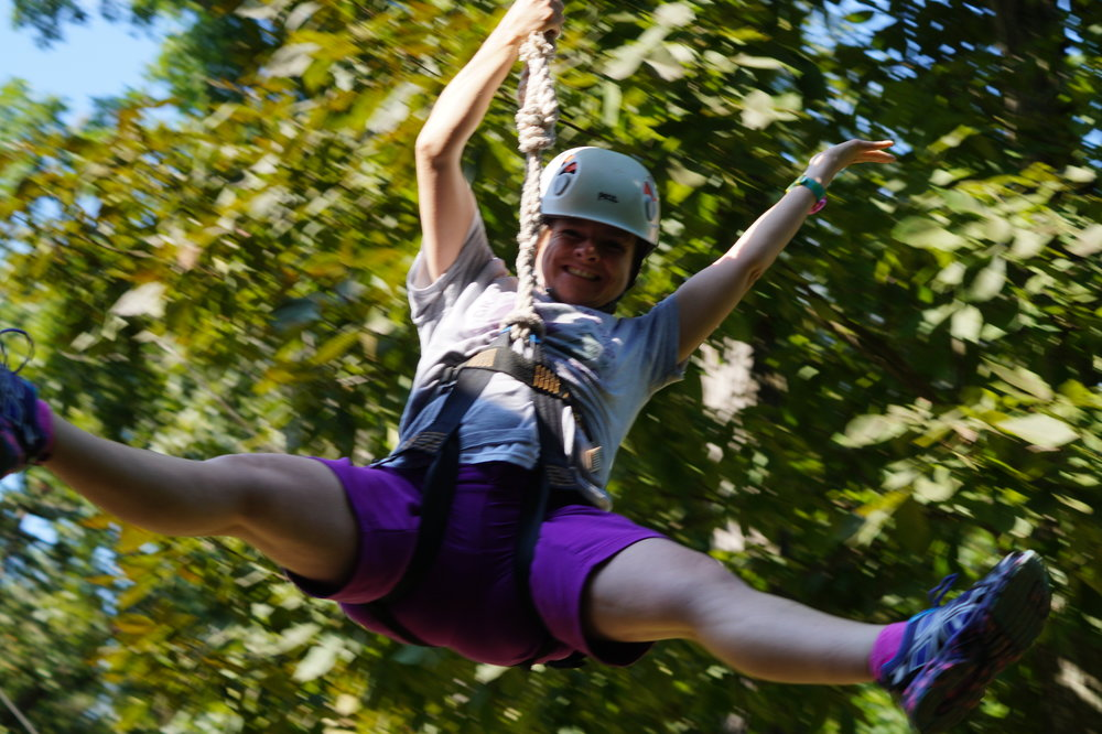 Having fun on the zipline