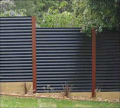 Modern, Simple, Private.  Black Corrugated Panels with Redwood Posts.