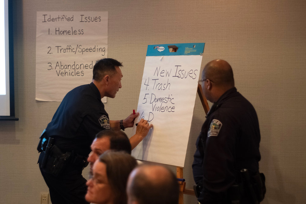 A meeting between APD Community Engagement Officers and District Representatives.