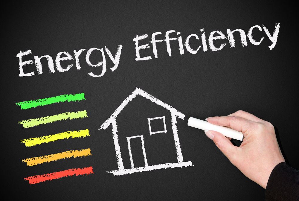 "Picture of house written in chalk detailing ""energy efficiency."""