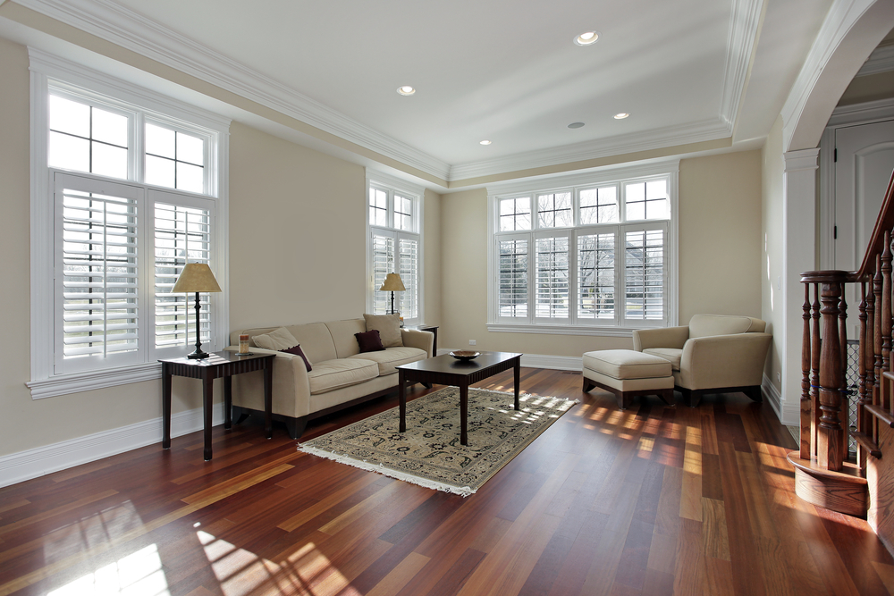 Large, expansive windows with cherry wood floor.