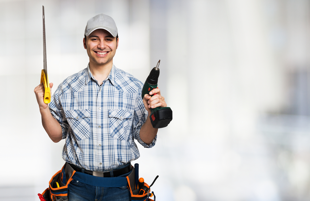 Man holding power tools.