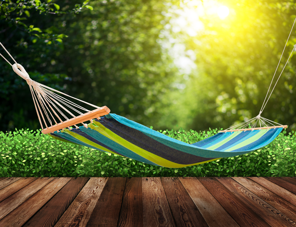 Vibrant-colored hammock in backyard.