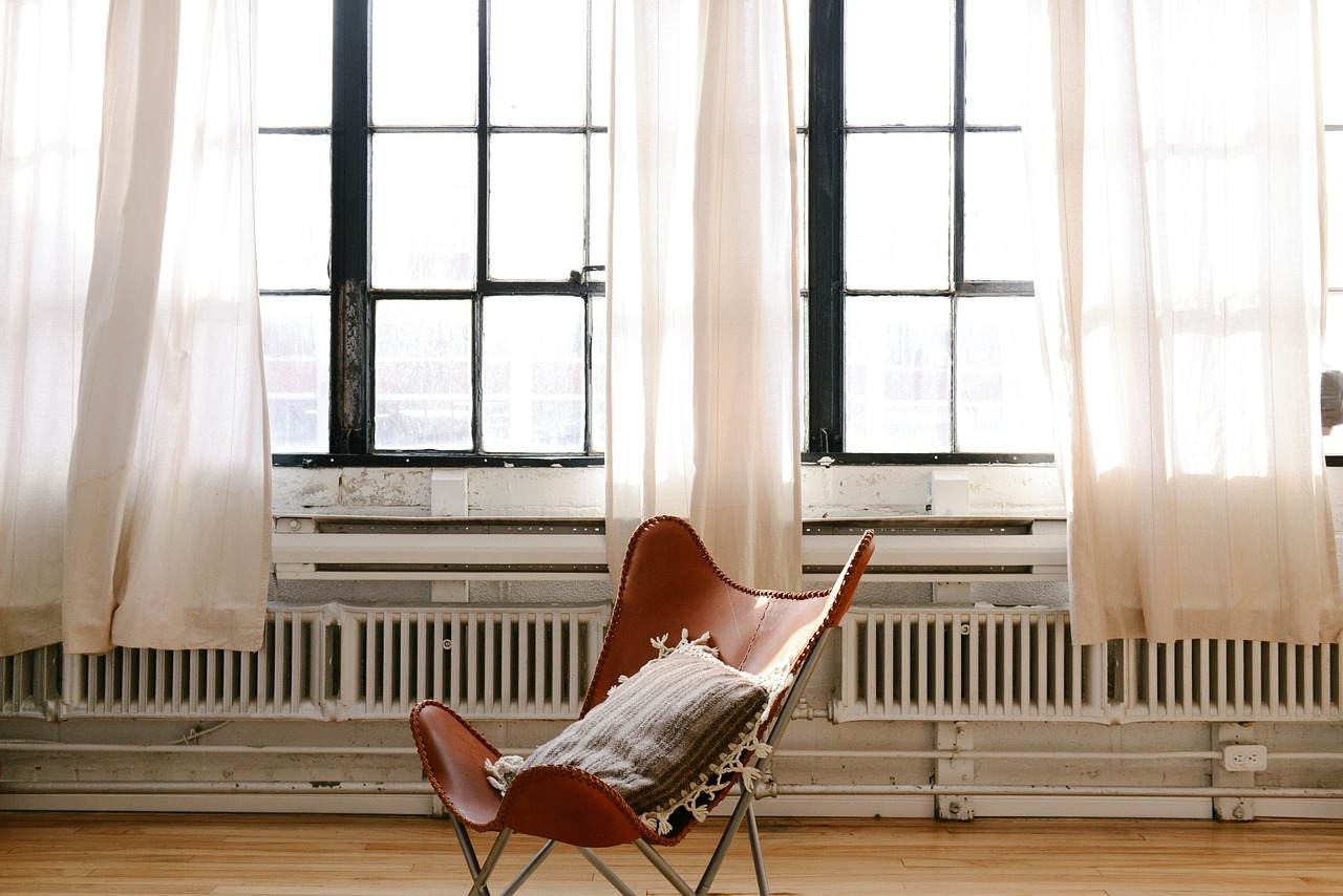 Window with curtains, hardwood chair