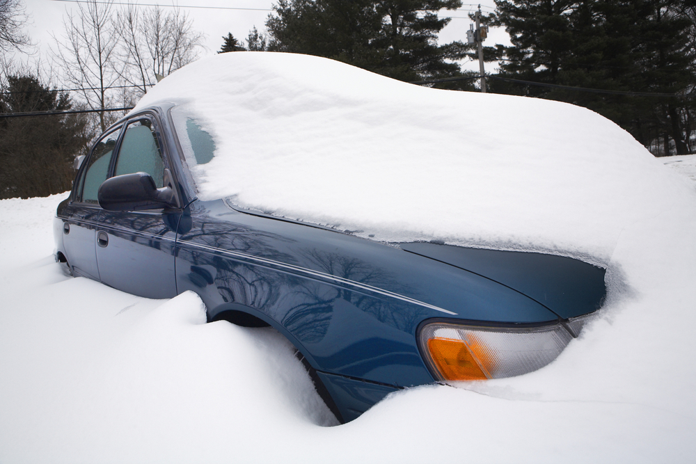 Car covered in snow during winter