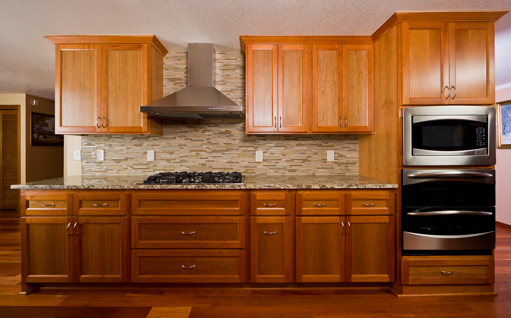 Brown cabinets compliments kitchen