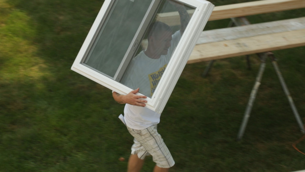 Guy walking w_ window over shoulder.jpg