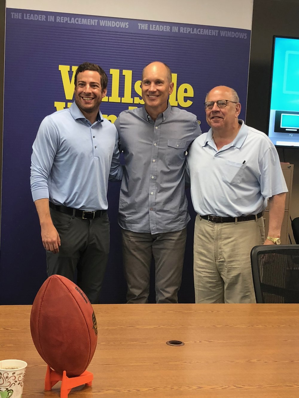 Adam Blanck, Jason Hanson and Stanford Blanck celebrate the Detroit Lions' visit to The Factory.