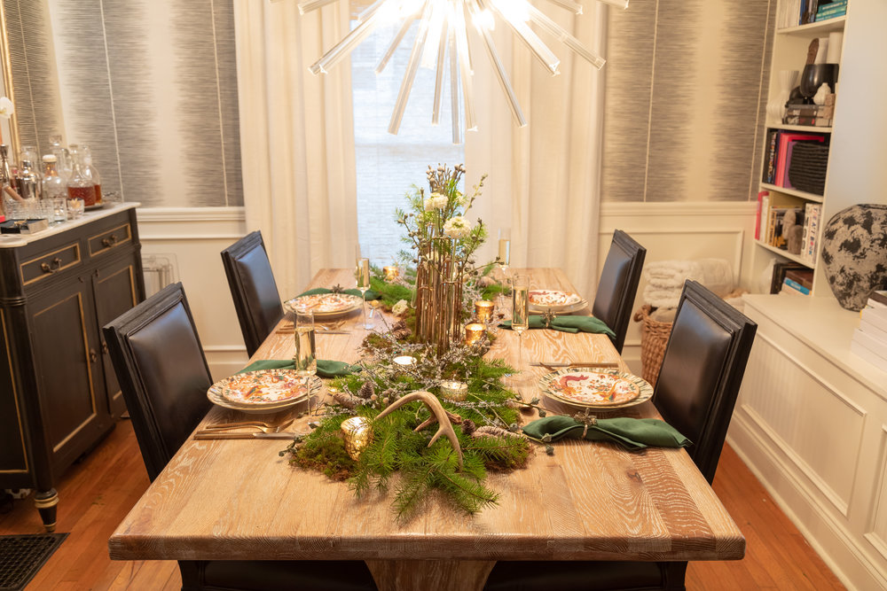 Woodland Wonder: Nordic & Neutral - A warm and inviting dining room for the holidays is a must! Together with Patricia Murray of Table Matters, we created this tablescape to showcase their handsome dishes and unbelievably cool hinged flower vases in antique brass.With this tablescape it was all about layering in smoky-bronze-meets-deep-tabacco accents as well as natural pieces like antlers and fraser fir branches (we got our holiday branch bundle from our local Trader Joe's).