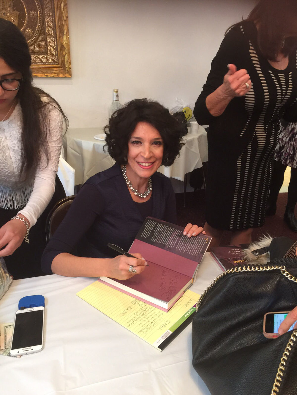 Cynthia signing her book after speaking at Congregation Bene Neharayim in Jamaica Estates, Queens.