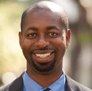 Dr. Godfrey Gibbison, C of C Professor