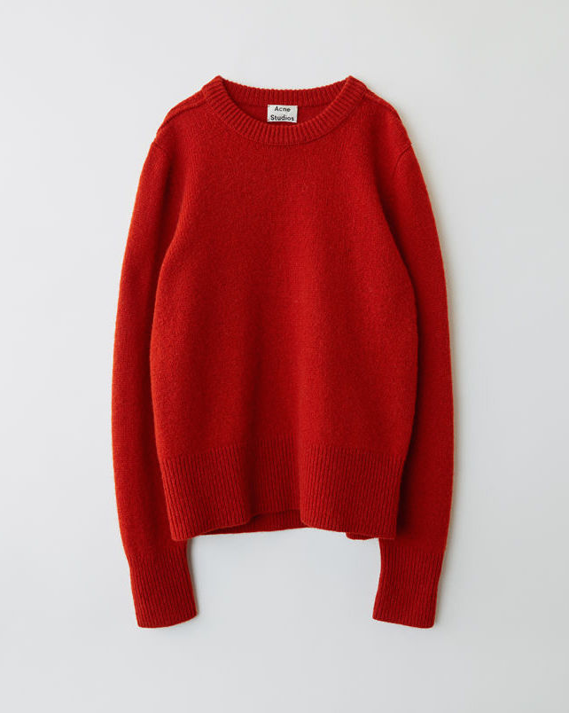 $300 - Acne classic red sweater   This classic red sweater is a holiday essential! The long ribbed cuffs gives it a modern twist so it's not identical to your creepy uncles red sweater.