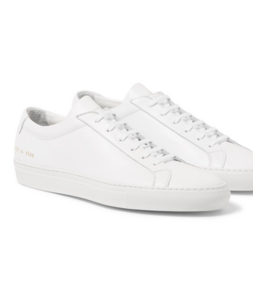 $410 - Common Project white sneaker   A classic white sneaker is a staple in any mans wardrobe! Common Projects is an iconic brand and makes some pretty fantastic white sneakers. They also somehow stay relatively clean compared to other white sneakers I own. The perfect gift for someone who's picky. You can't own too many white sneakers.