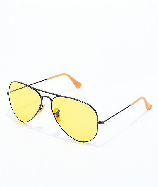 """$150 - Ray-Ban yellow aviators   I've had these glasses for a while now and love them! I call them my """"80s-porn-star"""" glasses. I love the yellow lenses with the black frame."""