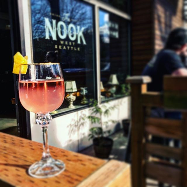 Patio Weather ☀️ and a Huckleberry Bubbles Special. Mmmmm . #thenook #thenookseattle #spring #summeriscoming #huckleberry #lemon #bubbles #patio #hideyourkidshideyourwife