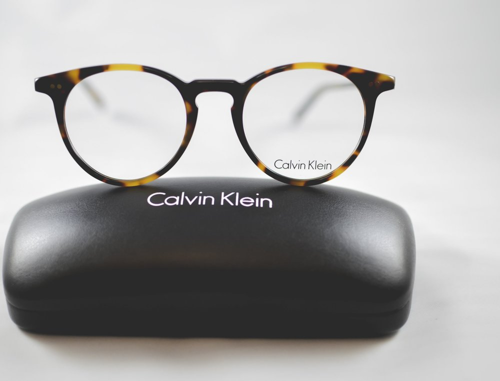 CALVIN KLEIN - This eyewear collection takes inspiration from the brands strong historical American roots while continuing to innovate with bold designs and styles.